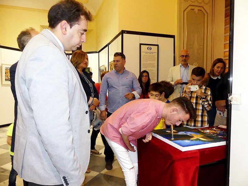 Diputación de Cuenca abre sus puertas al arte de una treintena de pintores con la boca y el pie de dieciséis países del mundo