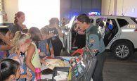 La Guardia Civil de Cuenca recibe la visita de los alumnos de la Escuela Municipal de Verano de la Capital conquense